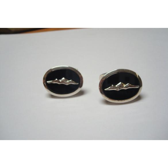 Gemelos en plata ovalados sobre piedra de onix